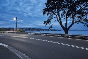 Backplate: Suburban road bend by city harbour at dawn